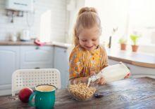 Girl_Pouring_Milk_On_Cheerios